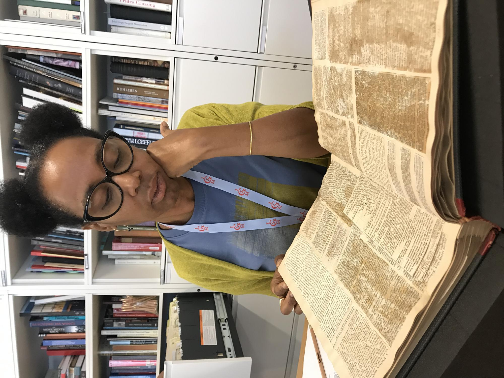 """Sonya Clark looks at Gardner's """"Commonplace Book"""" in the archives reading room, 2019"""