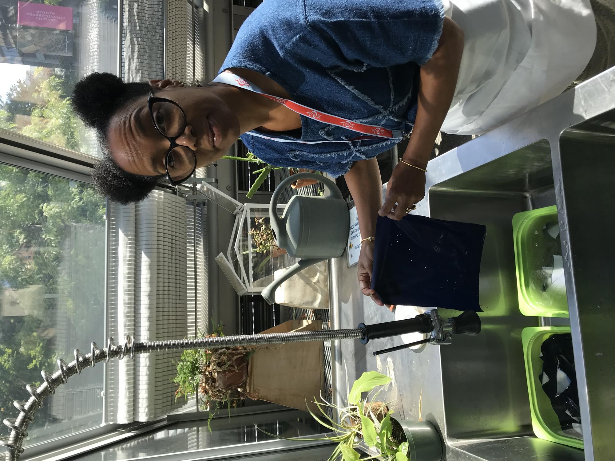 Sonya Clark working on cyanotype project in the Education Greenhouse, 2019