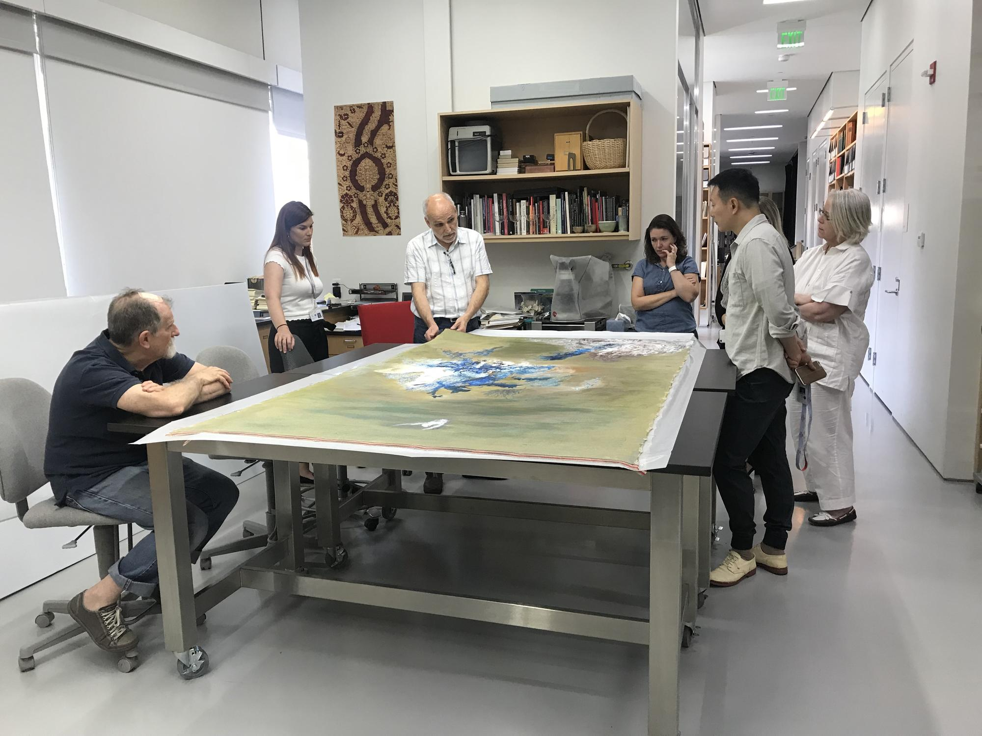 Shen Wei in the conservation lab preparing a work to be stretched for his upcoming exhibition, 2018