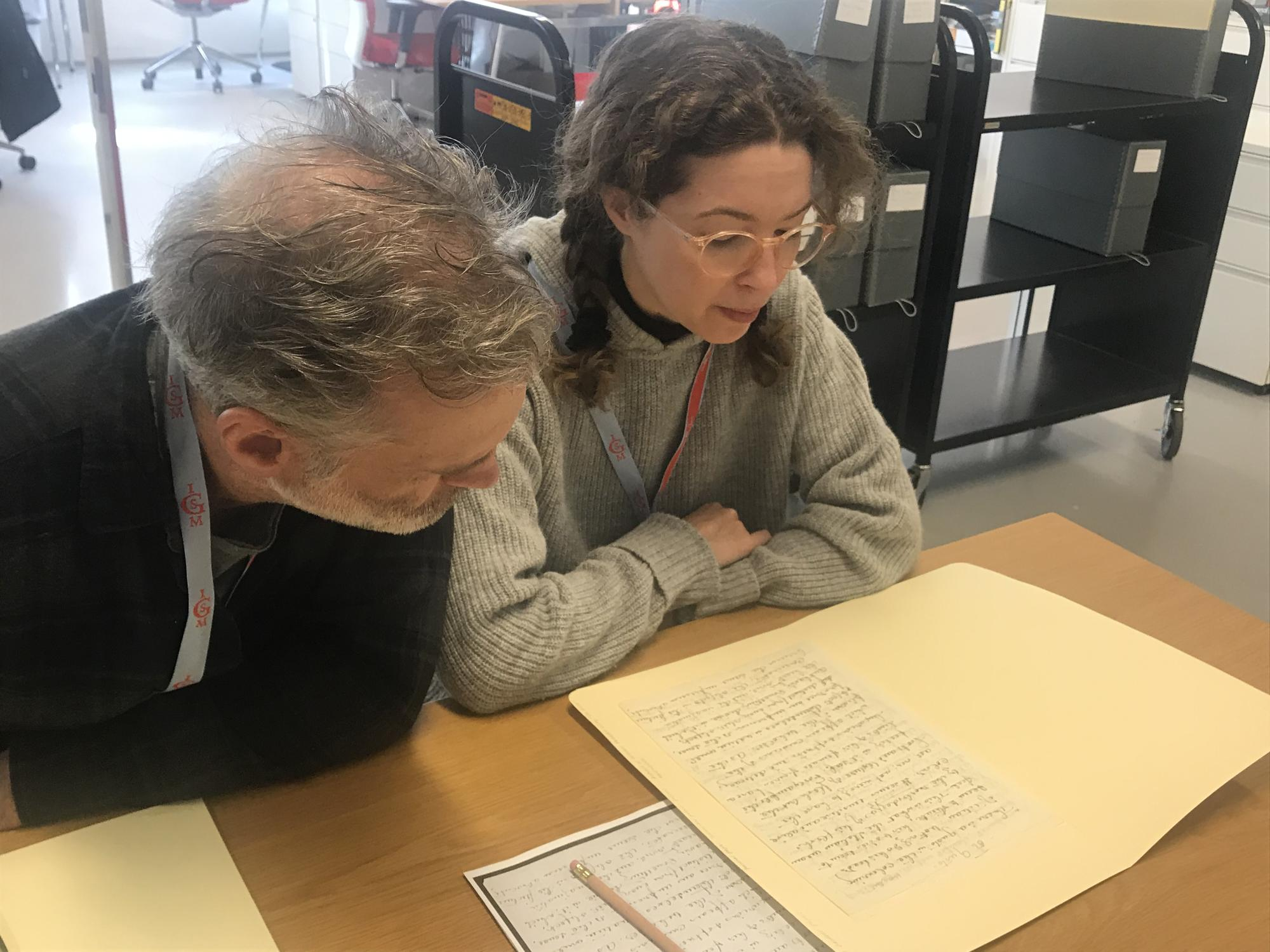 Mary Reid Kelley and Patrick Kelley in the archives, 2019