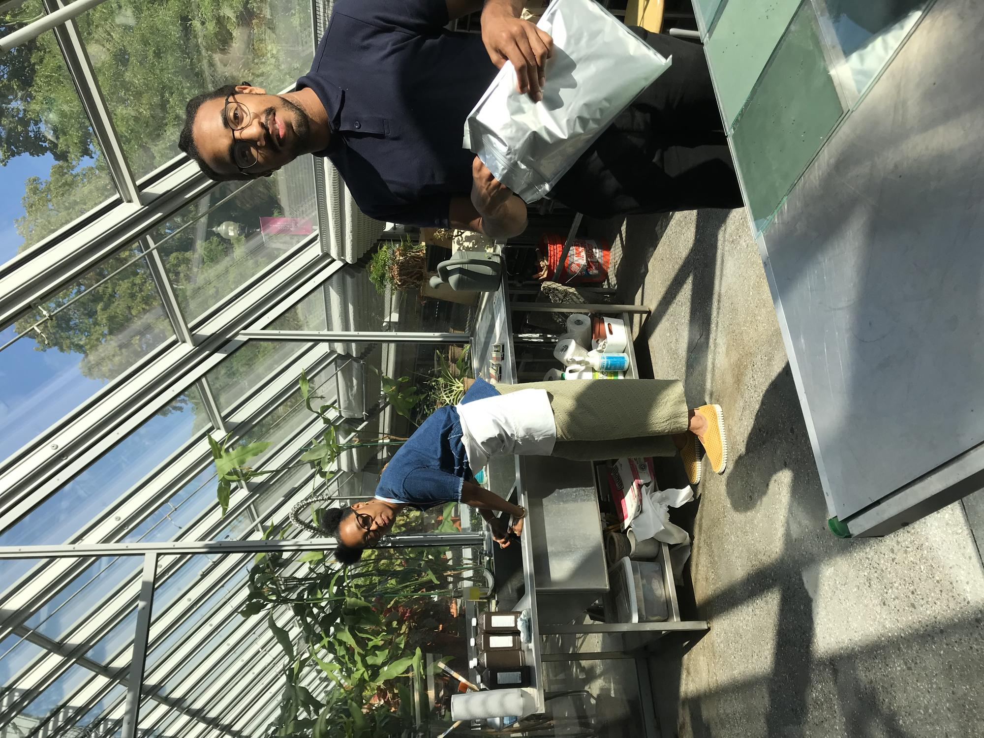 Sony Clark working on cyanotype project in the Education Greenhouse with Jonathan Jackson, 2019