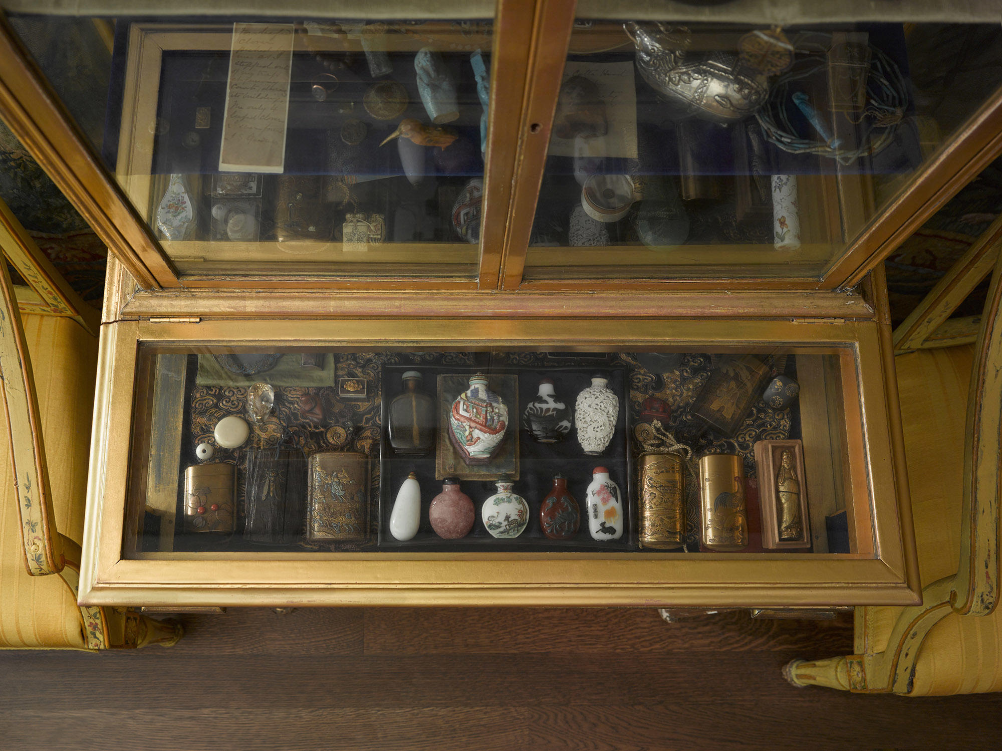Cabinet in the Little Salon with objects Isabella collected on her travels to China and Japan