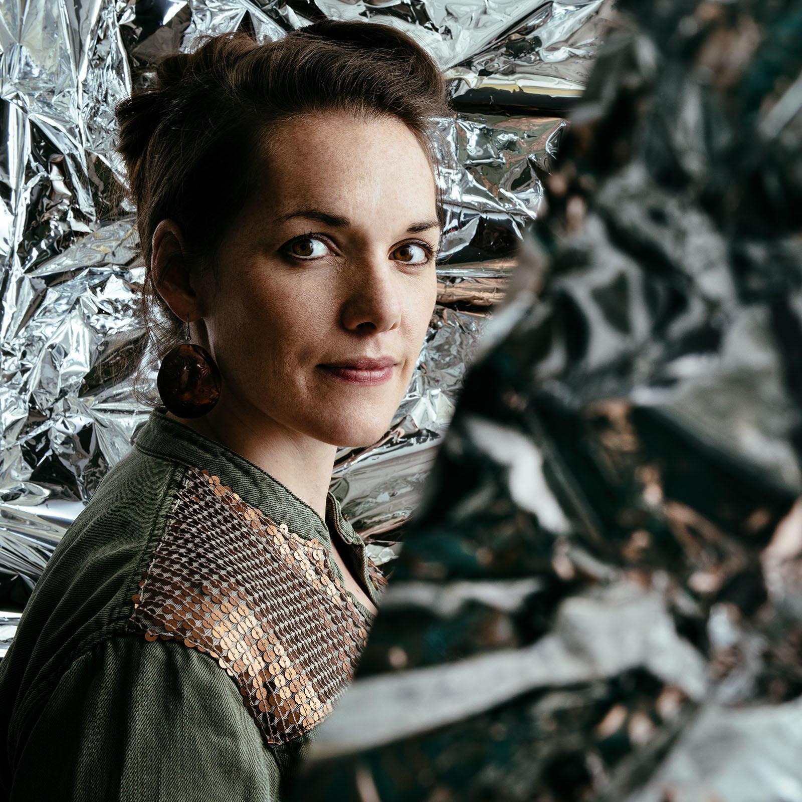 Maria Finkelmeier headshot amid crinkled reflective background