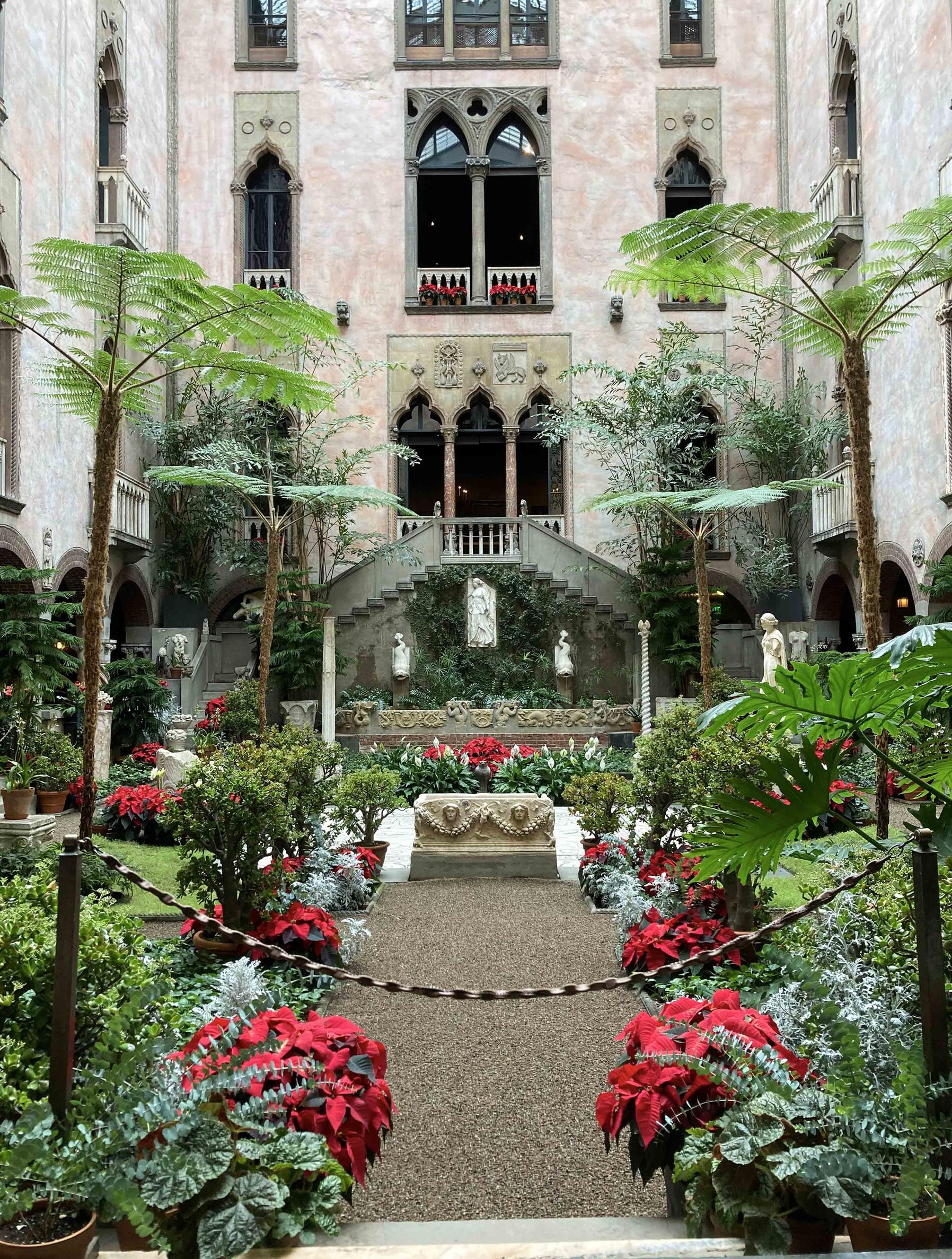 The festive Courtyard in December features flowering jade, juniper and poinsettia. Crimson, velvet amaryllis emerge from nests of fir, pine and magnolia.