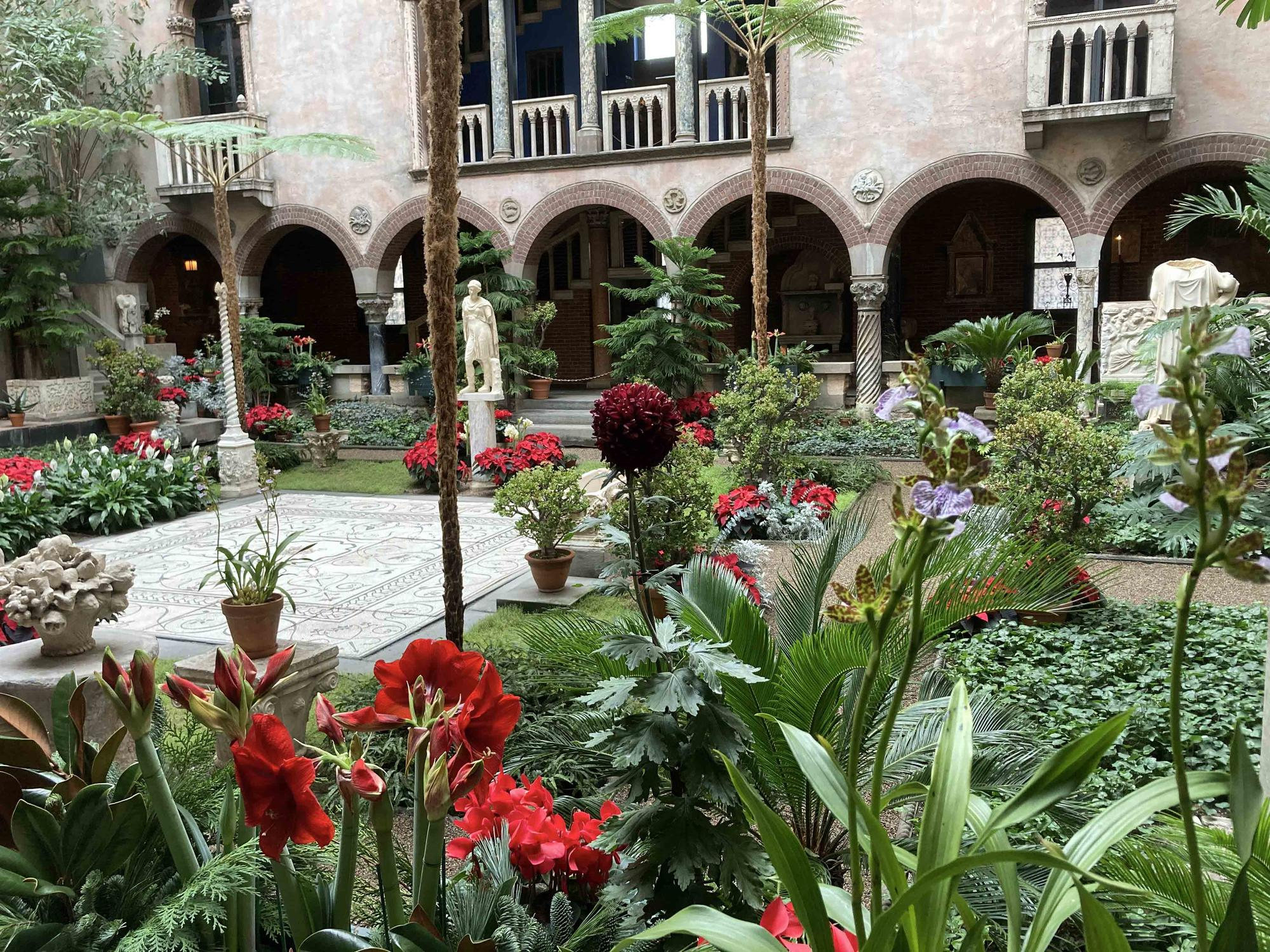 The gardeners adorn this lush holiday garden with jewel-like cyclamen and sweetly-scented Zygopetalum orchids.
