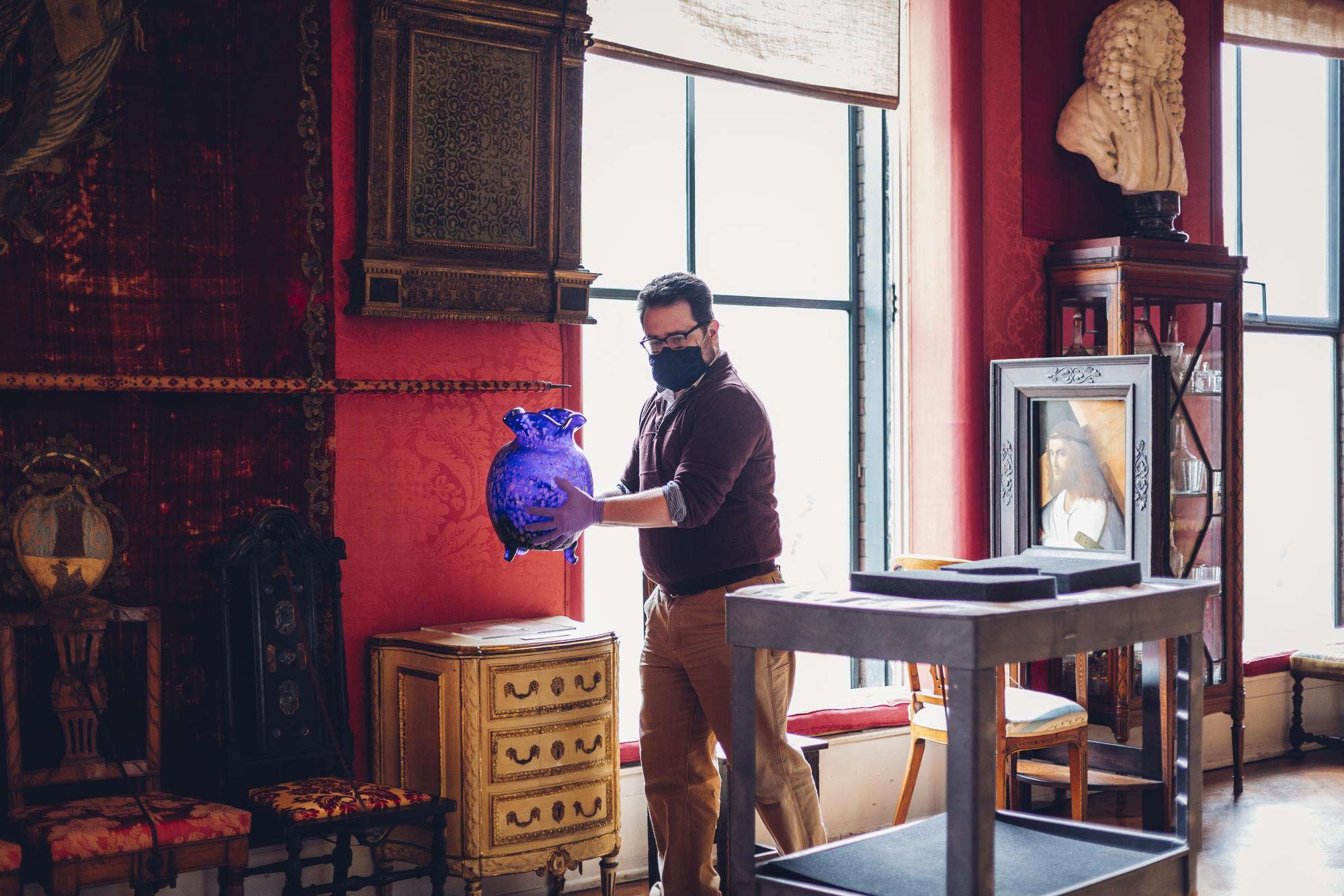 Matt DelGrosso moves an object in the Titian Room
