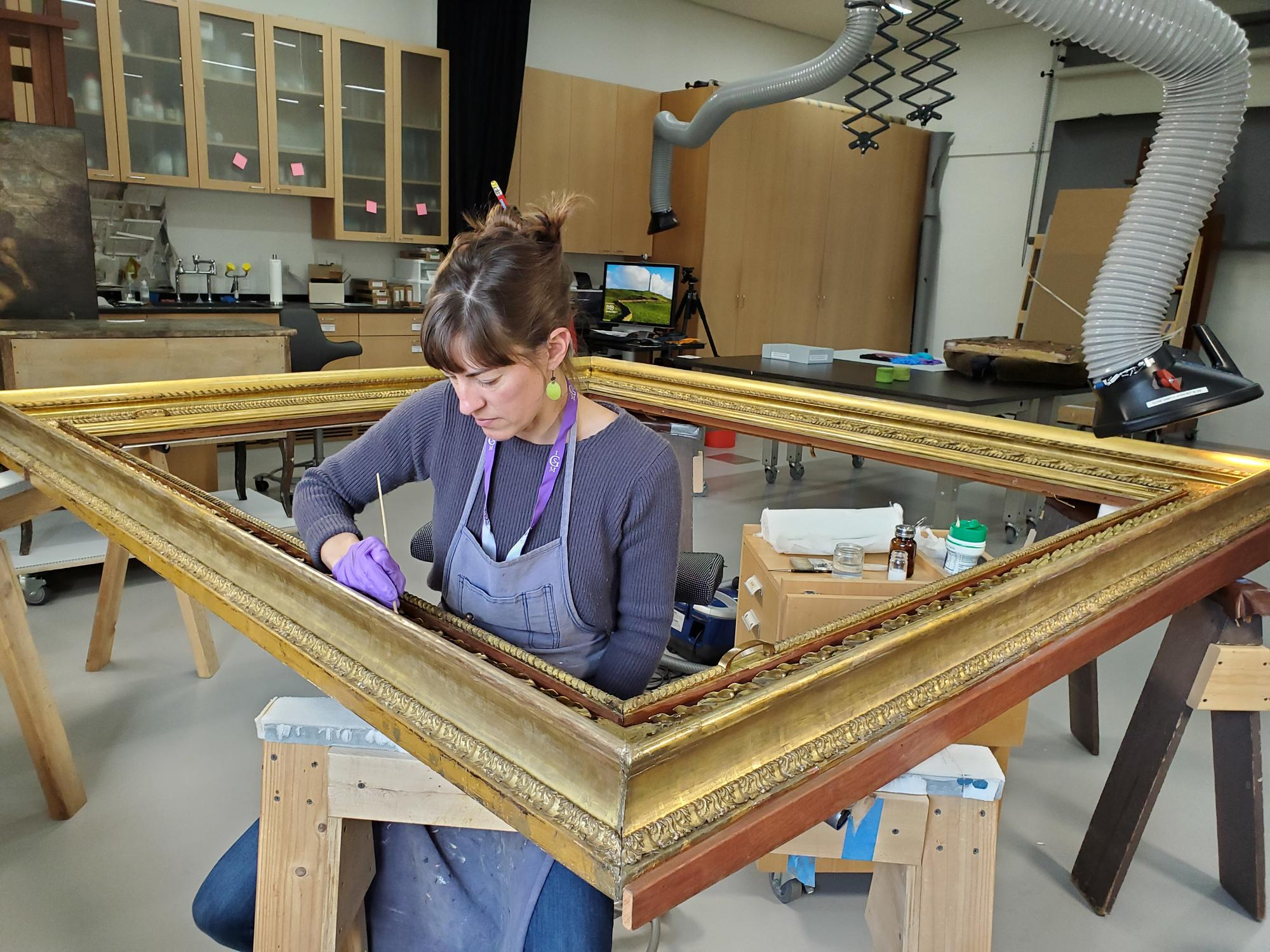 A conservation tech restores the frame of Titian's Rape of Europa