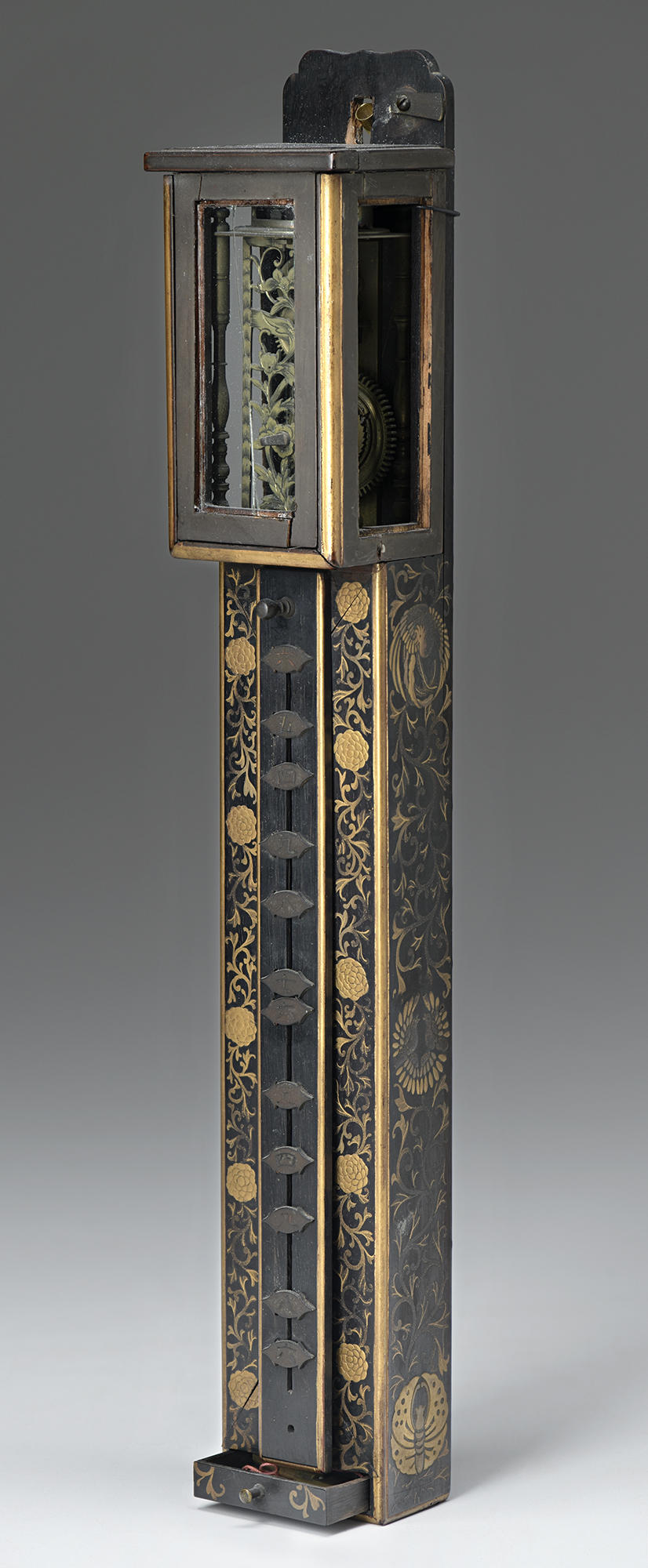 Japanese, Wall Clock, 18th century. Lacquered wood, with gold decoration and copper alloy fittings