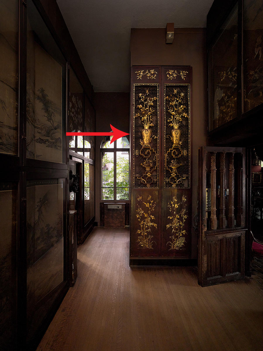 Second Floor Passage showing tall Chinese lacquer doors