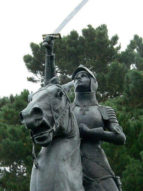 A close up of a black statue of Joan of Arc