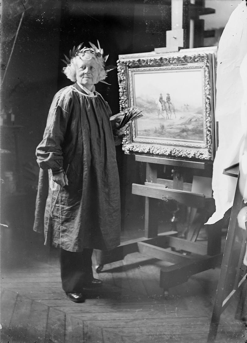 Black and white image of Rosa Bonheur with an easel