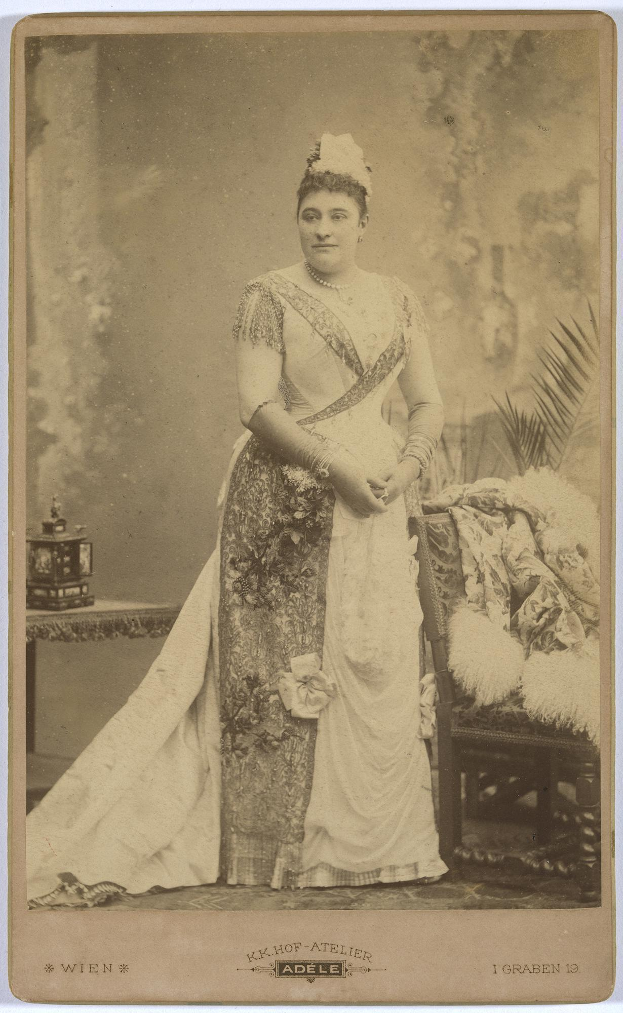 A regal woman in a dress posing for a photo.