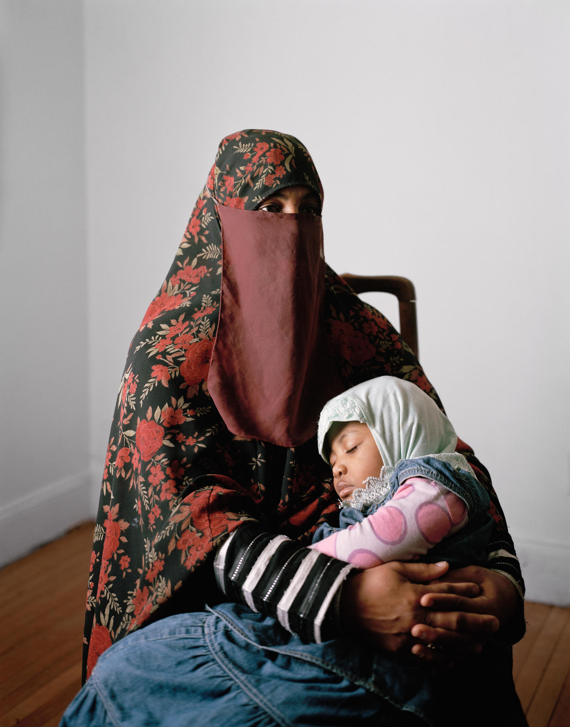 A mother with a niqab and her daughter.