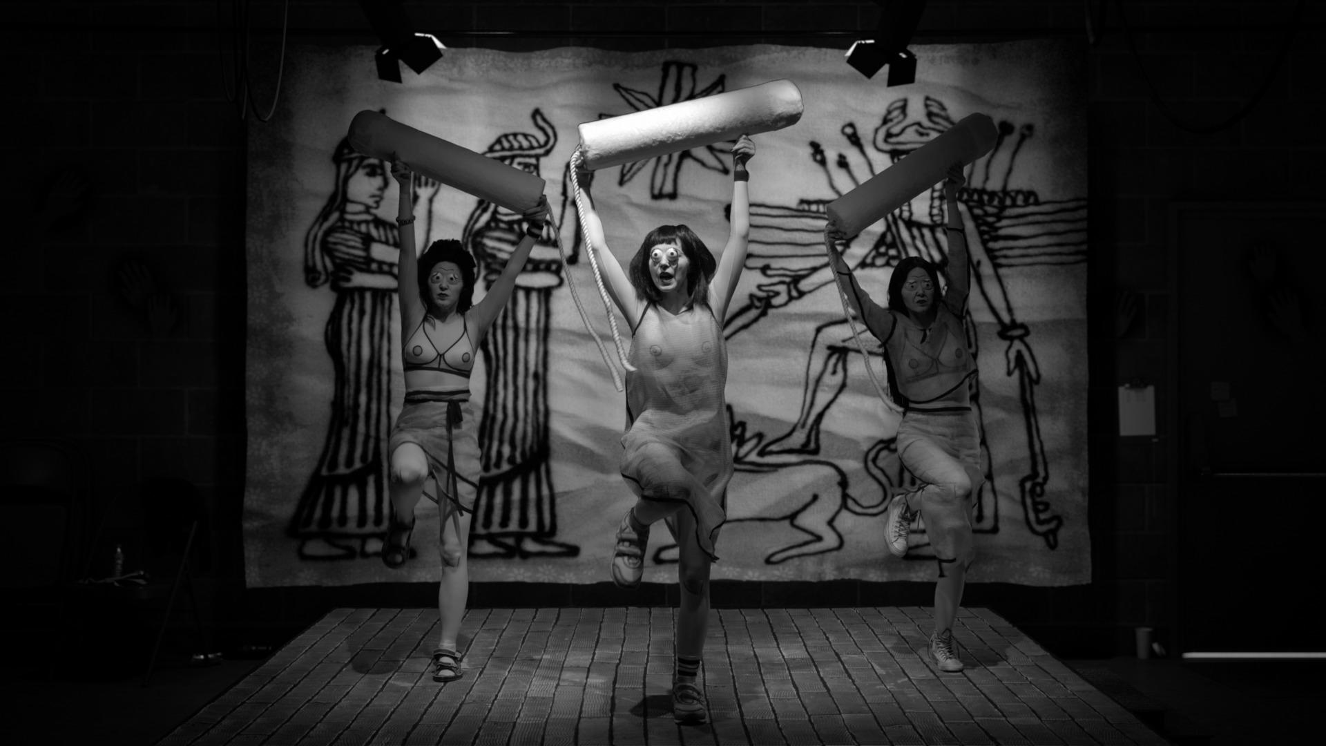 A clip from The Rape of Europa film with three women dancing with columns.