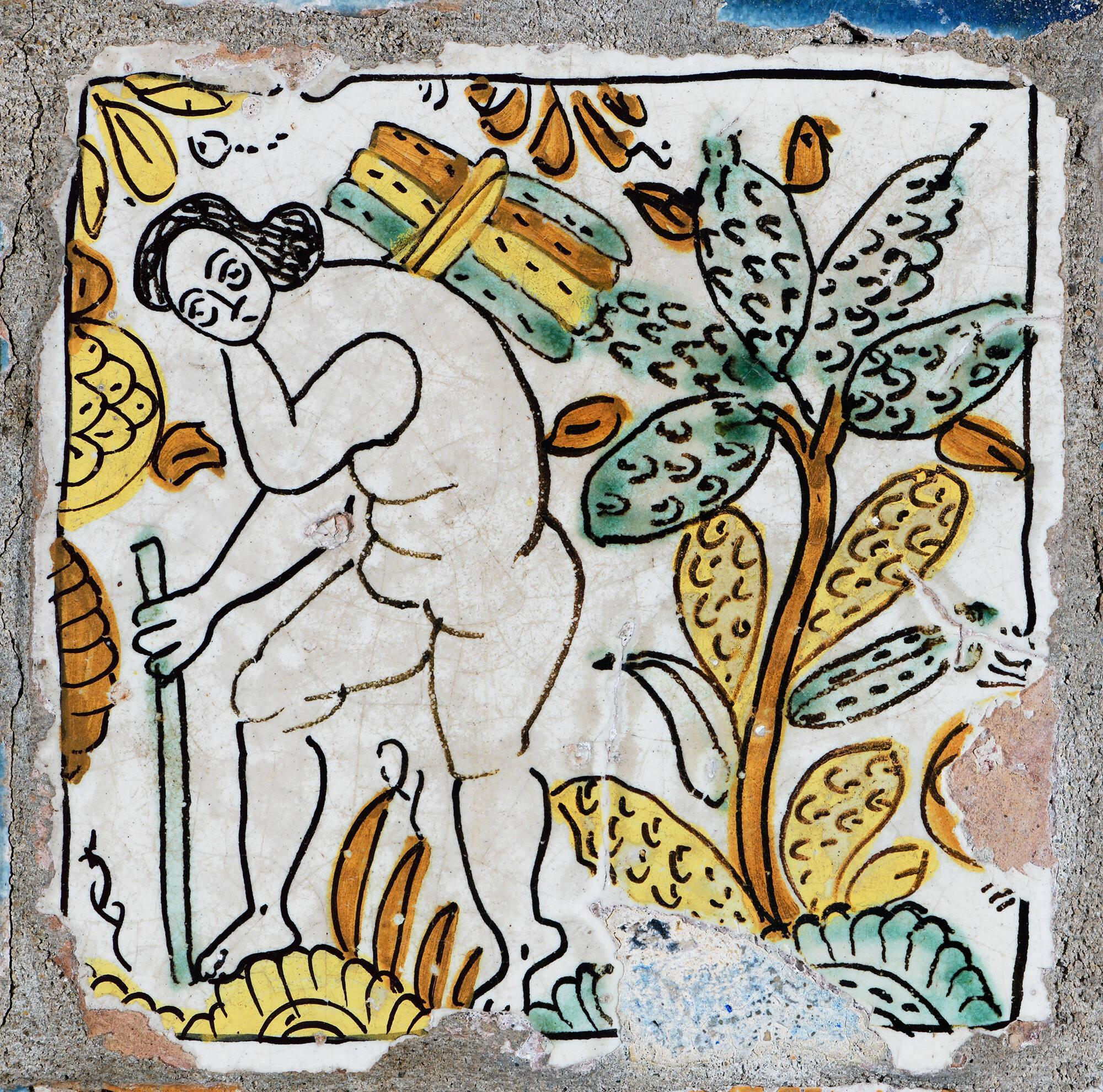 A naked human painted on a tile.