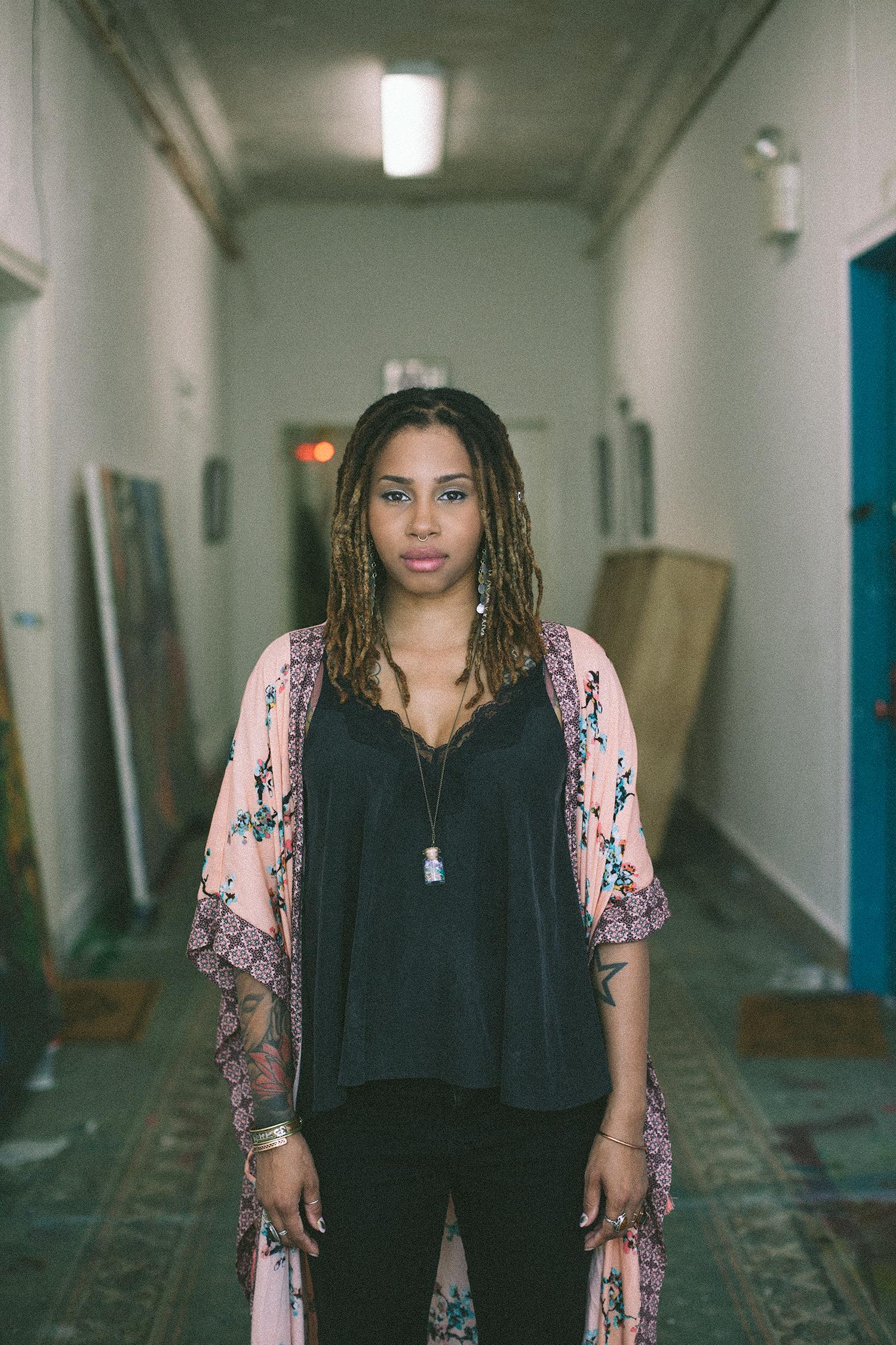 Fabiola Jean-Louis standing in a hallway.