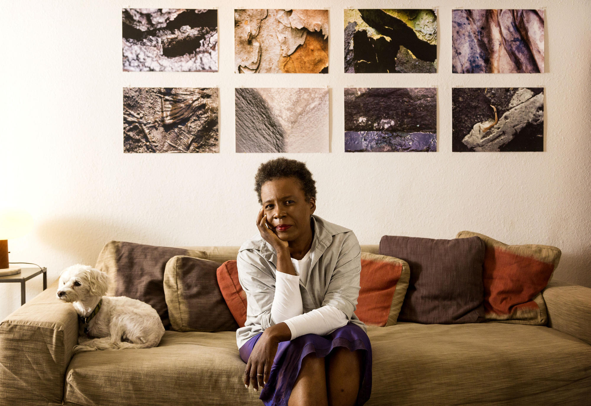 Claudia Rankine sitting on a couch.
