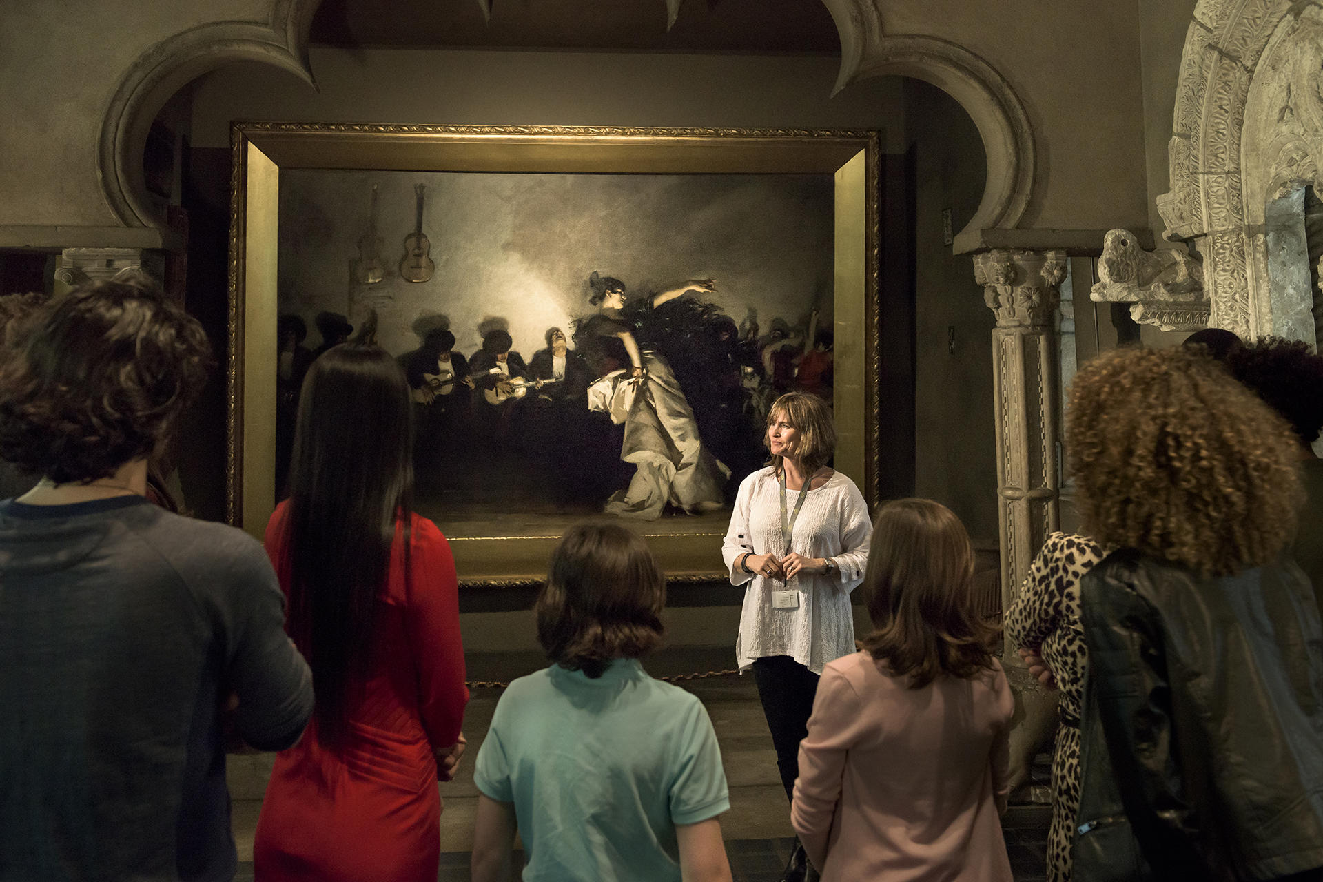 A Museum Teacher leads a tour in the historic Palace