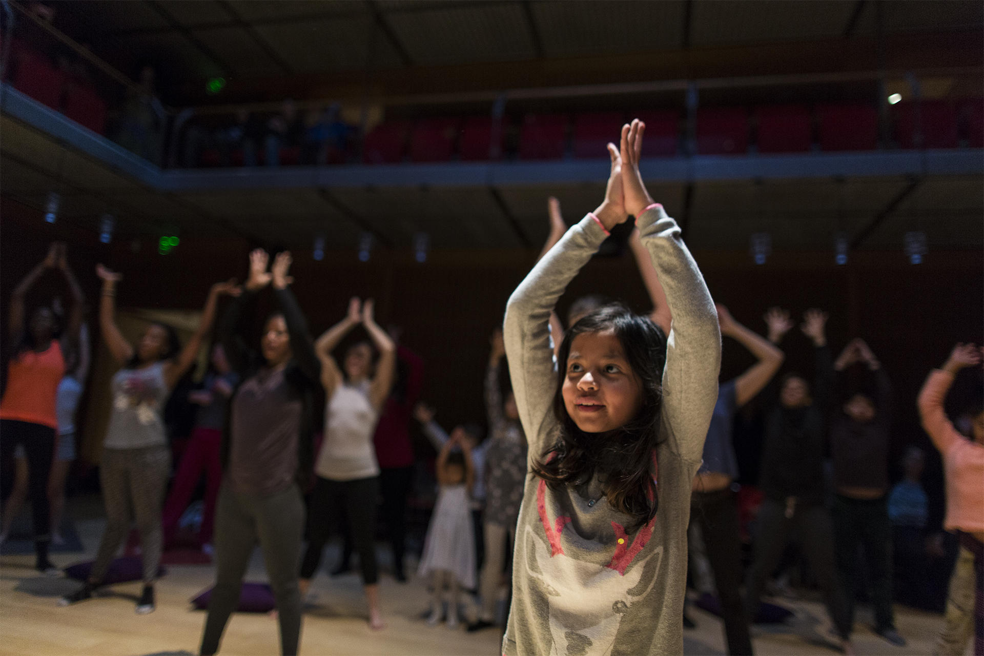 Visitors engaging in Afro Flow Yoga in Calderwood Hall. Photo by Leonardo March.