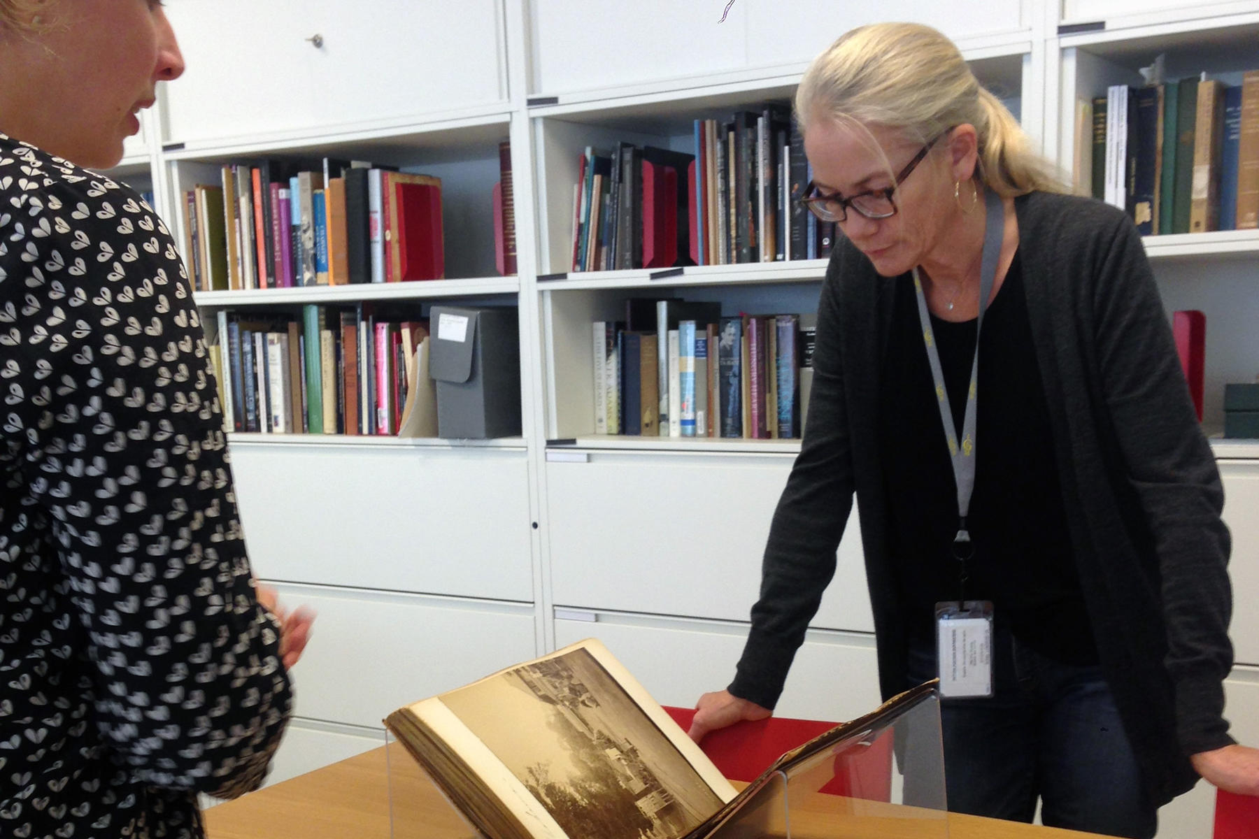 Rachel Perry viewing Isabella Stewart Gardner's travel scrapbooks in the archives, 2014