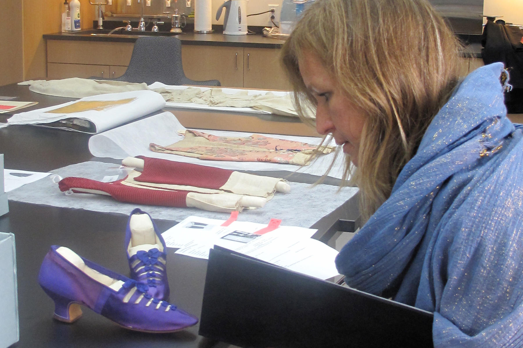 Wheatley sketching a pair of Isabella Gardner's shoes in the Textile Conservation Lab, 2012.