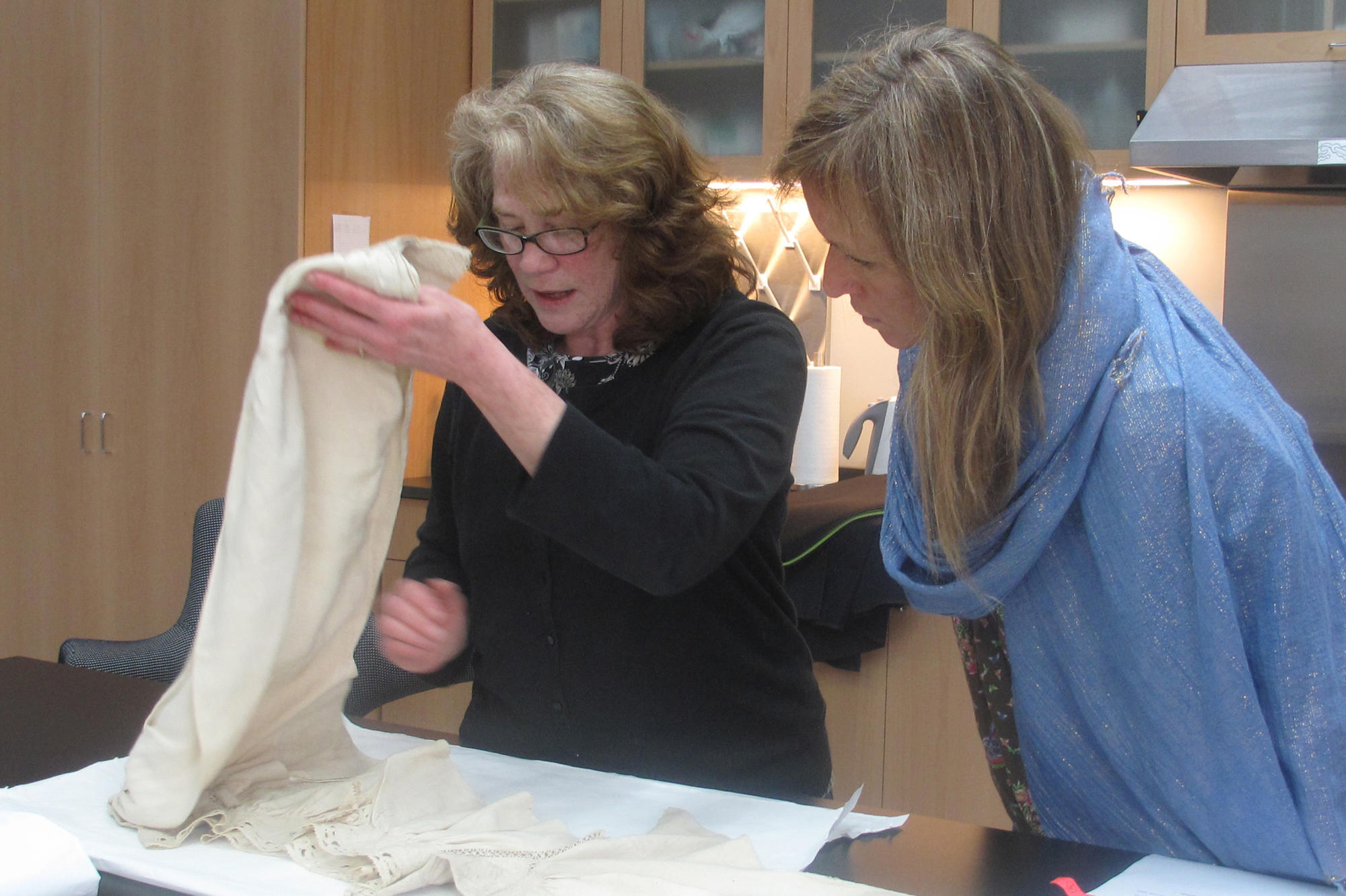 Charmaine Wheatley and Textile Conservator Tess Fredette looking at clothing in the Gardner's collection, 2012.