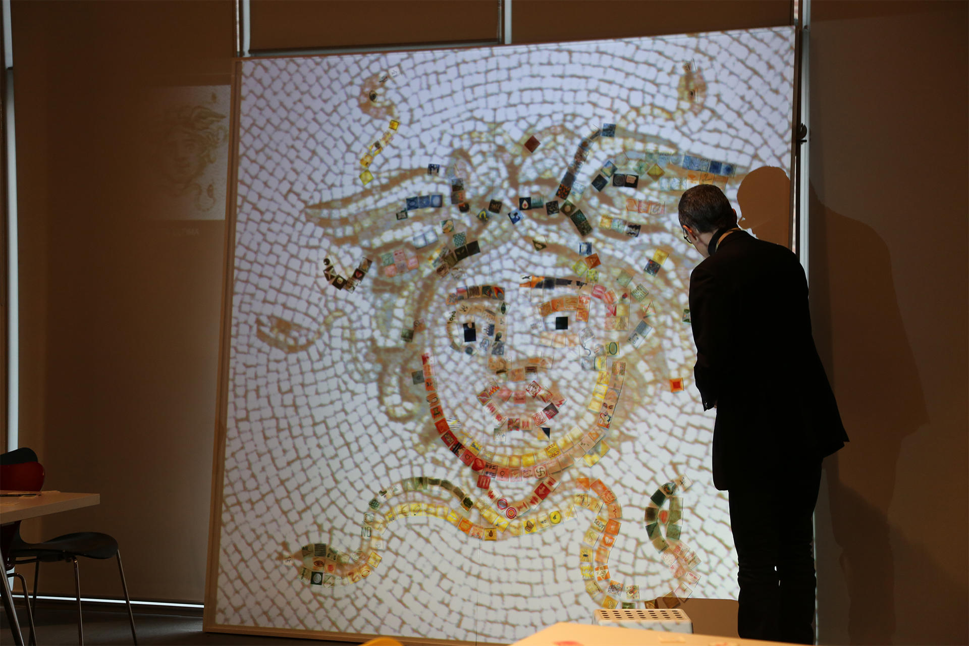 Cesare Pietroiusti with a projected image of the Courtyard Medusa Mosaic