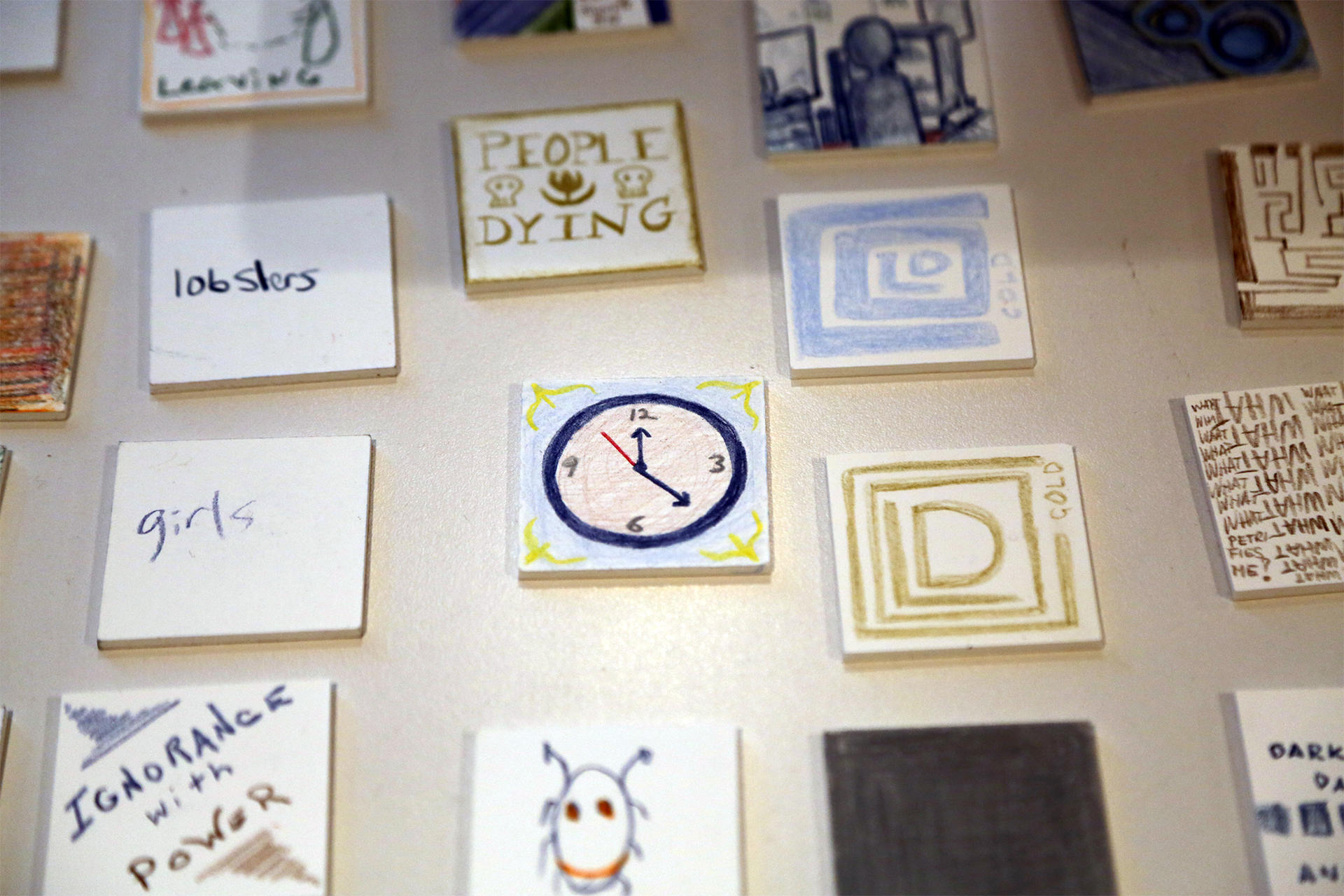 Mosaic tile drawings created by the public during Pietroiusti's workshop