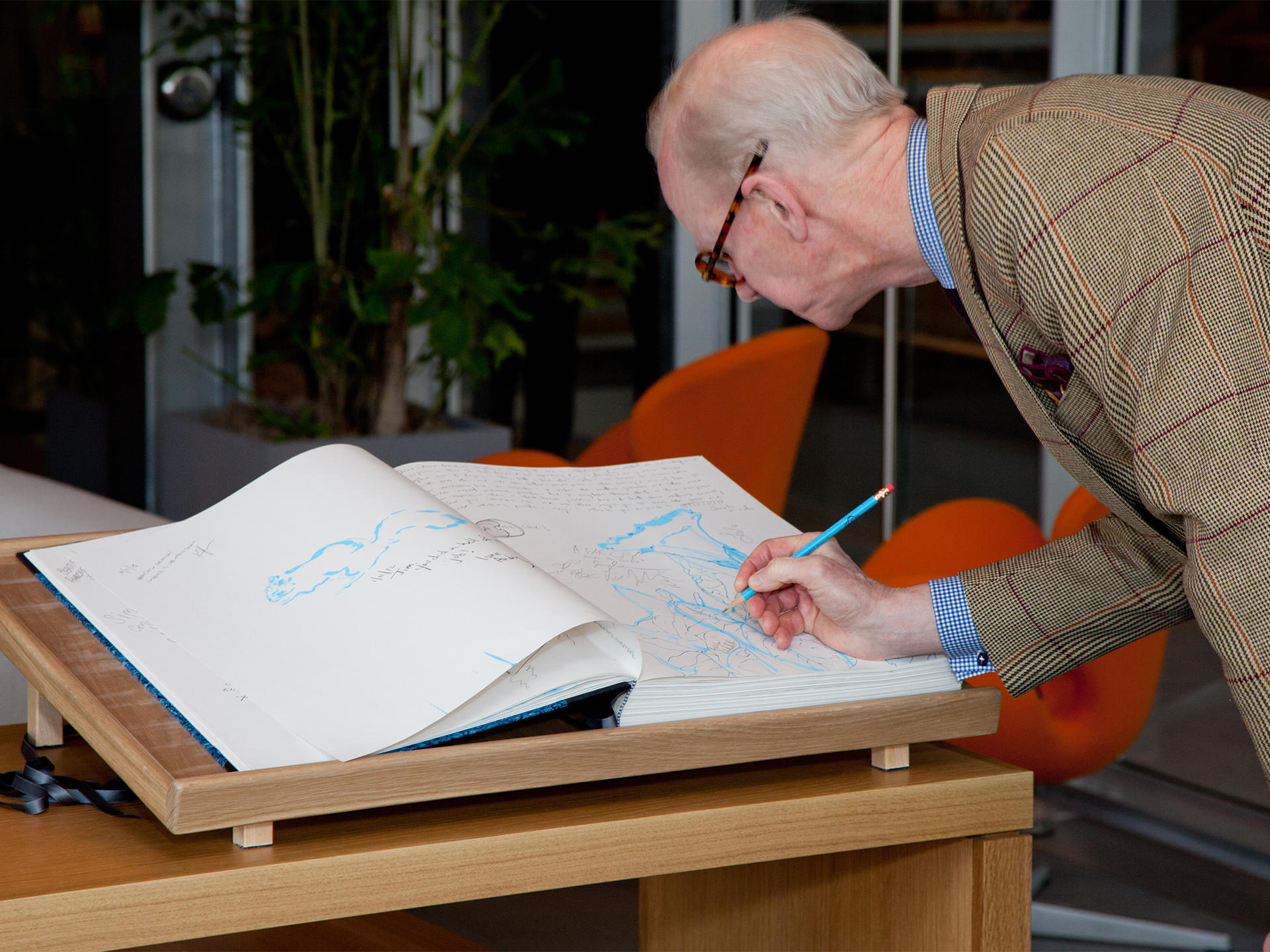 Guests signing in to the Libro Azzurro book designed by Arienti, 2012
