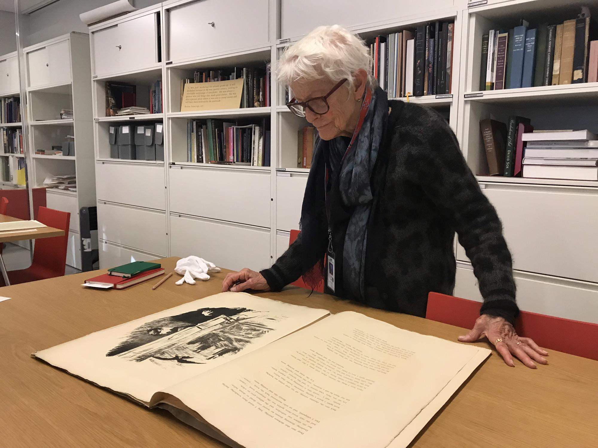 Joan Jonas looking at a special printed portfolio of The Raven by Edgar Allan Poe, with illustrations by Édouard Manet, published in Paris, 1875.