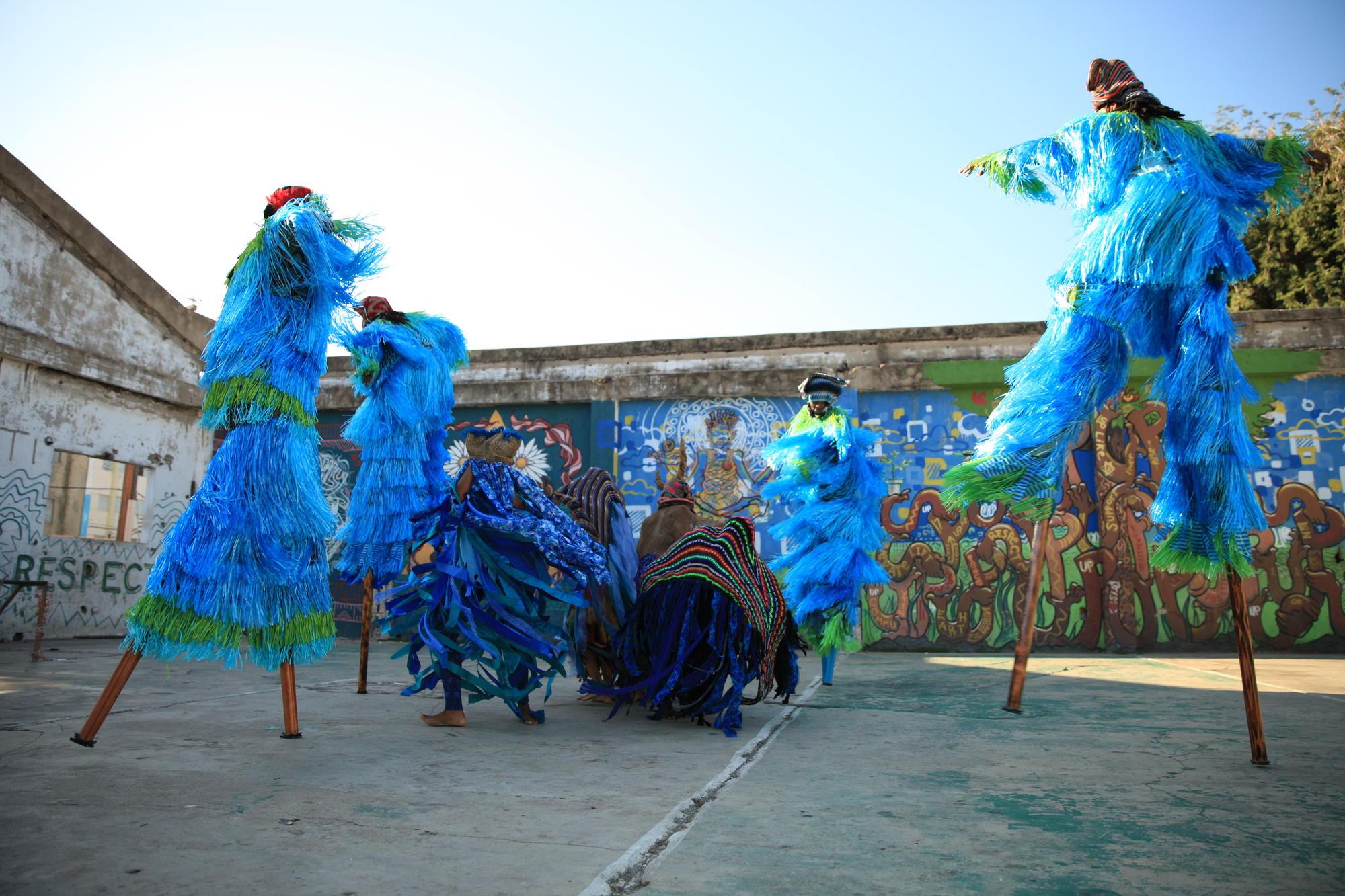 """Jumbies Street Performance"" in Jamaica. Thyssen Bornemisza Art Contemporary - Academy for Ocean Calling by Laura Anderson Barbata, 2017."