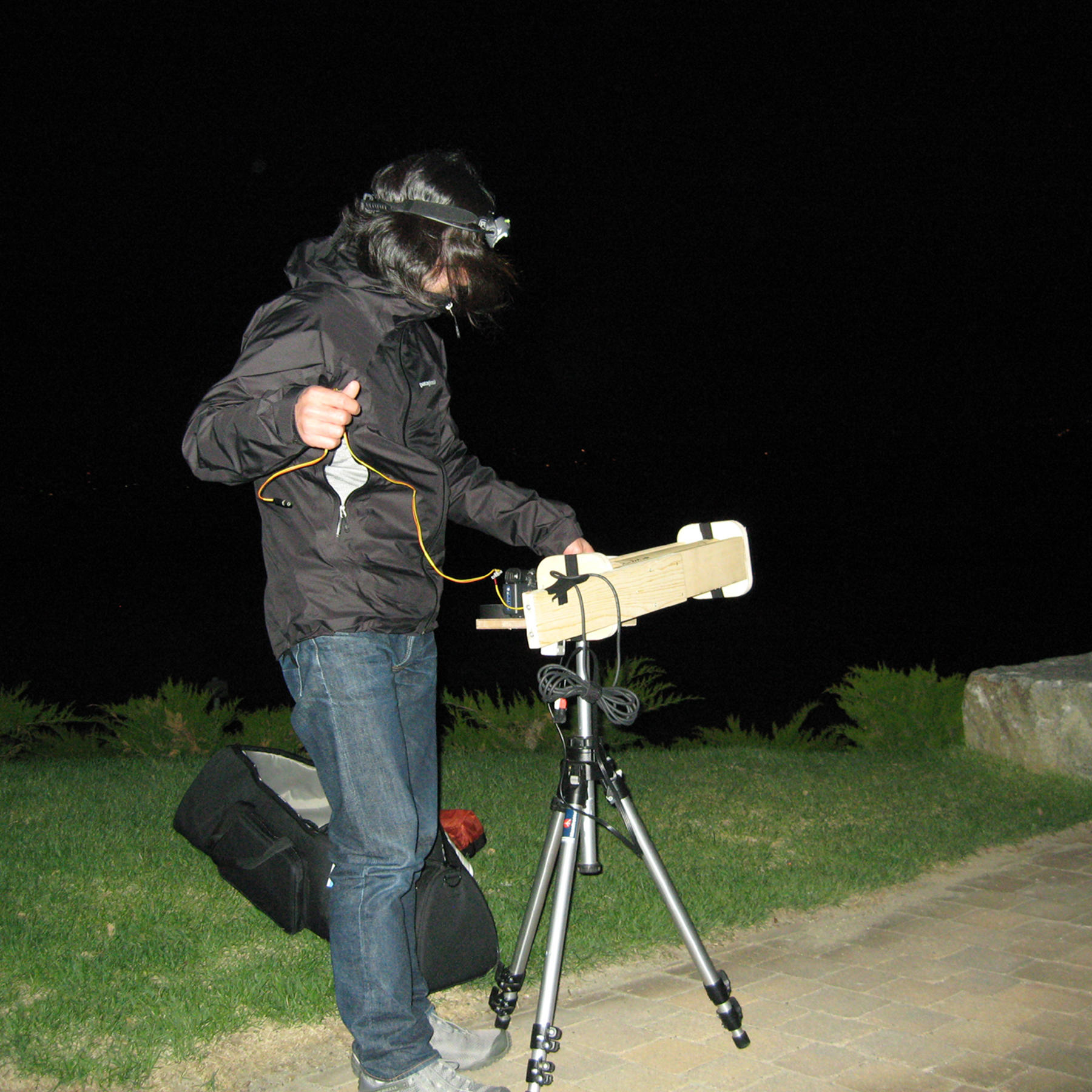 Taro Shinoda filming the moon and Boston with the telescope he built, 2007.