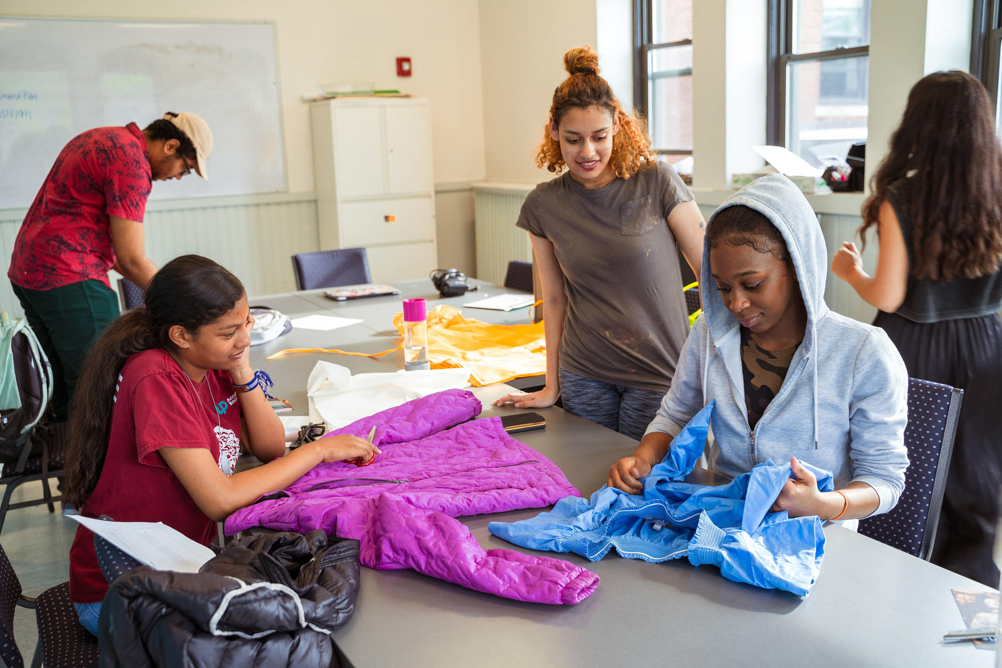 Hyde Square Task Force students work on their Map This garments. Photo by Faizal Westcott, June 2019.