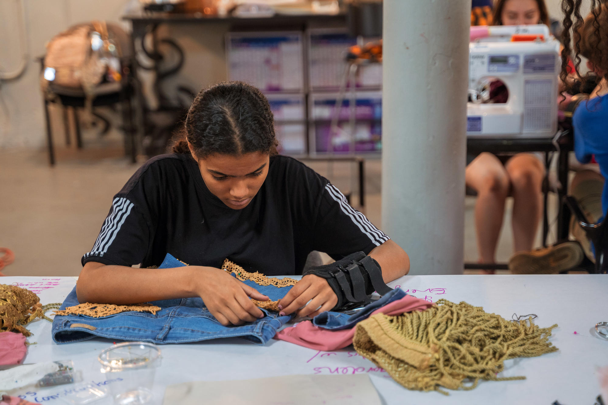 An Urbano Project student works on their Map This garment.