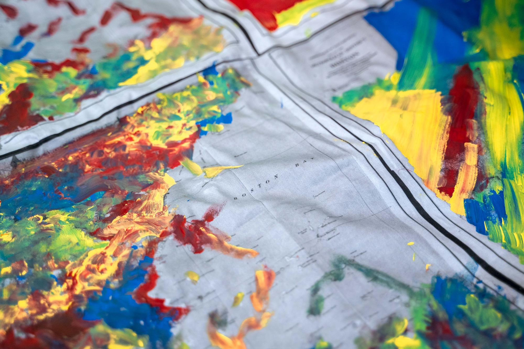 A close-up shot of a rainbow map-inspired textile created by Urbano Project students.