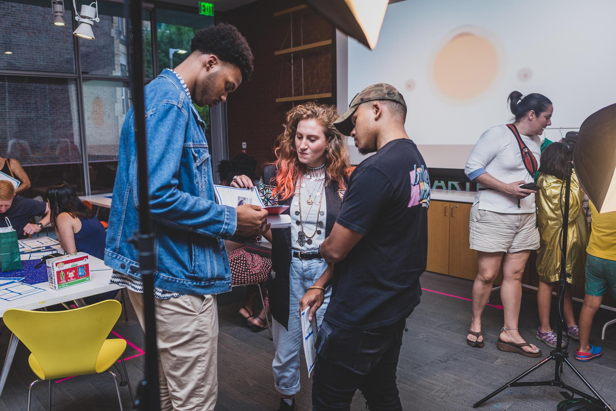 Visitors talk with Polly Thayer Starr Visiting Studio Artist and Neighborhood Salon Luminary Feda Eid during a 2019 Neighborhood Night.